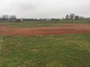 repaired school baseball field after regrading and proper drainage installation by Parks' Waterproofing