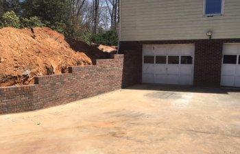 driveway brick retaining wall by Parks' Masonry